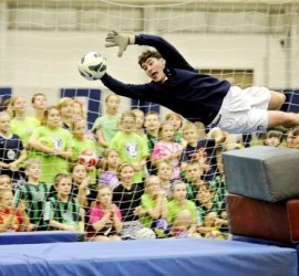 Penn State soccer goalie Danny Sheerin demonstrates how to dive to block a ball during the Mack Brady soccer clinic at Holuba Hall on Sunday. Nittany Lion soccer coaches and players led the free clinic for more than 100 youngsters. ABBY DREY — CDT photo